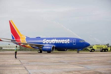 Photo of Southwest employee comforting young flier goes viral