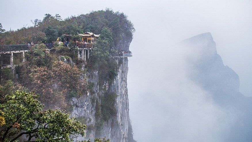 A new walkway-- the Coiling Dragon Cliff skywalk-- has opened on the side of China's Tianmen Mountain in the Zhangjiajie National Forest Park.