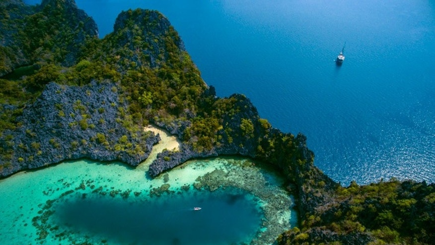 The stunning Mergui Archipelago in Myanmar is one Black Tomato's premier drone-worthy destinations with its deep cobalt ocean, dramatic escarpments and white beaches.