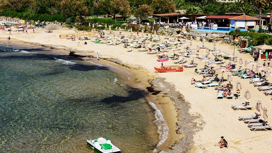 Authorities from the coasts of Tuscany to Sardinia are cracking down on tourists who save prime beach spots for friends.