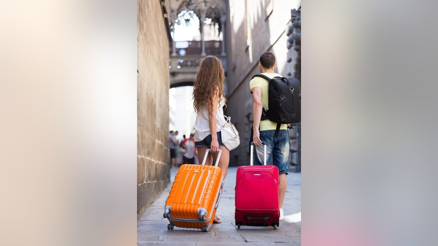 Missing something? Newlyweds wish they had more luggage to cart around the world.