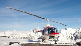 A helicopter on a mountain in winter. Panorama.