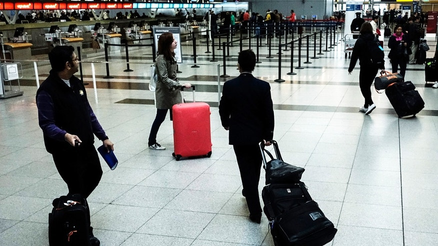 Passengers make their way to the security checkpoint at the John F. Kennedy airport in New York City.
