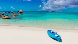 Boat at paradise beach in Seychelles, tropical island Praslin - Anse Lazio
