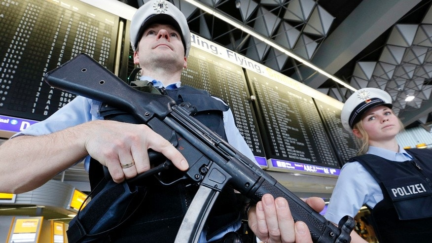 In this March 23, 2016 file photo, German police officers guard a terminal at the airport in Frankfurt, Germany, after security measures were increased after the Belgium attacks the previous day. The European Union unveiled plans on Wednesday, Nov. 16, 2016, for a new system of security checks on travelers permitted to enter Europe without visas in an effort to crack down on extremists.
