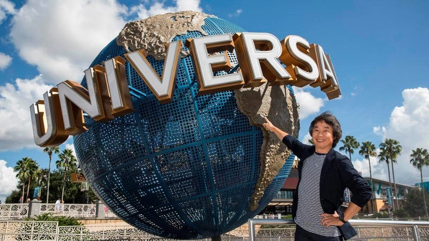Nintendo's creative fellow Shigeru Miyamoto stands in front of the iconic Universal globe at Universal Orlando Resort in Orlando, Fla.