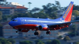 A Southwest Airlines jet comes in to land at Lindbergh Field in San Diego, California February 25, 2015. Southwest Airlines Co said it pulled 128 aircraft out of service on Tuesday after it discovered that they were overdue for a required check of the standby hydraulic system that serves as a backup to the planes' primary systems.  REUTERS/Mike Blake (UNITED STATES - Tags: TRANSPORT BUSINESS) - RTR4R5QH