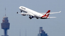 A Qantas Airways Airbus A330-300 jet takes off from Sydney International Airport over the city skyline, December 18, 2015.     REUTERS/Jason Reed/File photo - RTX2R40T