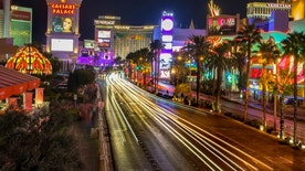 Las Vegas, USA - September 24,2015 - Photo taken at Las Vegas Boulevard.  Caesars Palace, The Mirage are in this picture from Las Vegas, under a night sky.  Photo taken at horizontal orientation. Many cars and people on the street.