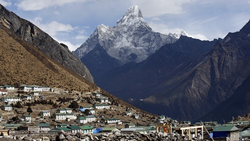Mount Ama Dablam is seen behind Khumjung a typical Sherpa village in Solukhumbu District also known as the Everest region.