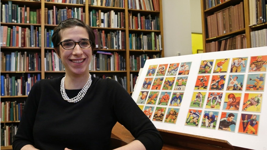 Jan. 8, 2014: Assistant curator Freyda Spira, of the department of drawings and prints, poses with football cards.