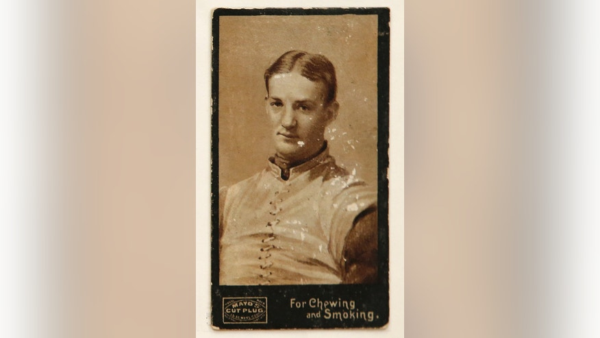 Jan. 8, 2014: This 1894 football card of Harvard's John Dunlop is the rarest in a collection of football cards to be shown at the Metropolitan Museum of Art in New York.