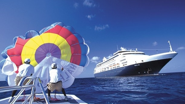 Guests can get the excitement of being in the air, with the view of the ship and the beach, while parasailing from Half Moon Cay.