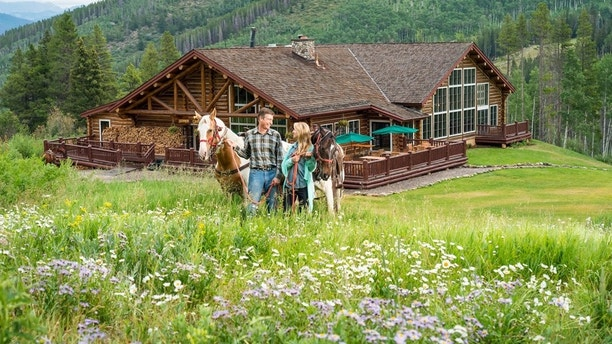 Arriving at Beano's Cabin on Beaver Creek, Colorado by horseback.