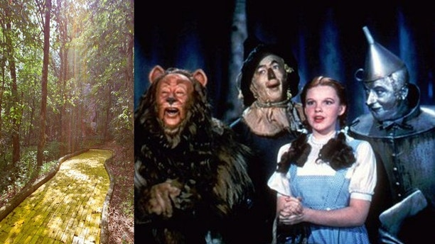 "FILE - In this 1939 file photo originally released by Warner Bros., from left, Bert Lahr as the Cowardly Lion, Ray Bolger as the Scarecrow, Judy Garland as Dorothy, and Jack Haley as the Tin Woodman, are shown in a scene from ""The Wizard of Oz.""   (AP Photo/Warner Bros., file)"