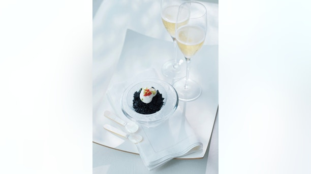 Champagne and caviar in a white lifestyle setting. Lots of copy space.