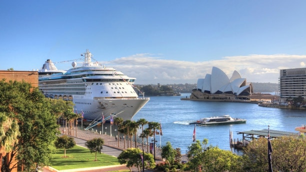 Sydney, Australia - December 1, 2013;  Royal Carribean Cruise Liner, Radiance of the Seas docked at Circular Quay in Sydney.   Sydney Opera House in background.  This ship boasts floor to ceiling windows and an outdoor cinema playing first run movies.