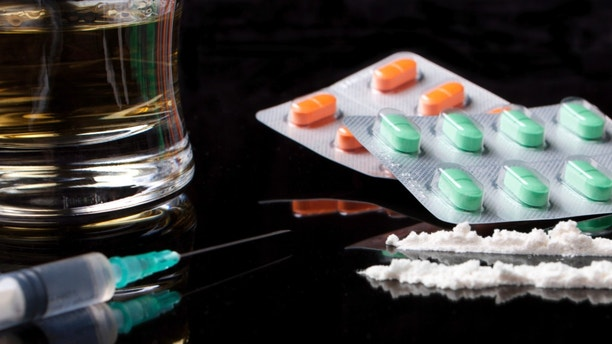drugs and pills on black background with reflection