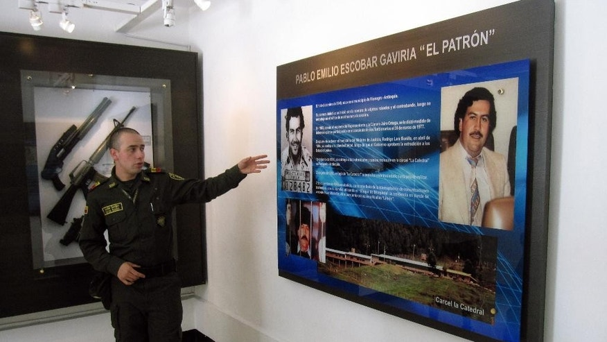 Dec. 31, 2013: Kevin Riano explaining an exhibit about Pablo Escobar at the National Police Museum in Bogota