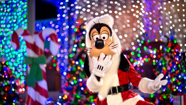Santa Goofy joins the fun during The Osborne Family Spectacle of Dancing Lights at Disney's Hollywood Studios. Making nightly appearances on the Streets of America, this jovial character greets guests in Goofy's Winter Wonderland. The Osborne Family Spectacle of Dancing Lights sparkles nightly throughout the holiday season at Walt Disney World Resort in Lake Buena Vista, Fla. (Kent Phillips, photographer)