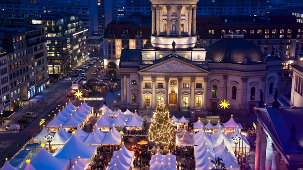 christmas market on berlin gendarmenmarkt at night