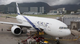 Hong Kong, China - July 17, 2013 : El Al Israel Airlines Boeing 777-200 parked at Hong Kong International Airport. It is the flag carrier of Israel. Many workers working at the airport area.