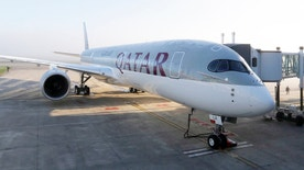 An Airbus A350 XWB is pictured on the tarmac during the first delivery of this new passenger jet at Qatar Airways in Toulouse, southwestern France, December 22, 2014. European planemaker Airbus delivered its first A350 mid-sized jetliner to Qatar Airways on Monday and moved to end speculation about the future of its larger A380 superjumbo. REUTERS/Regis Duvignau (FRANCE - Tags: TRANSPORT BUSINESS) - RTR4IYZ2