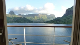 A view of Opunohu Bay and surrounding landscape in Moorea, French Polynesia, from a cruise ship balcony.