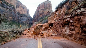CORRECTS DATE TO JAN. 14 - In this Saturday, Jan. 14, 2017, photo released by the National Park Service shows the Zion Scenic Drive closed just north of the Zion Lodge at Zion National Park, Utah. Nobody was injured, but officials say Zion Scenic Drive is impassable just north of Zion Lodge and will remain closed until further notice. Park officials say the slide occurred late Friday, covering both lanes of the road with about 200 tons of massive boulders and debris that stretch about four car lengths. It's not immediately known when the closed stretch of road will reopen.  (Salah Ahmed/National Park Service via AP)