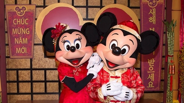 This January 2016 image provided by Disneyland Resort shows Mickey Mouse and Minnie Mouse dressed in red for a Lunar New Year celebration at Disney California Adventure Park in Anaheim, Calif. The park will celebrate year of the rooster this year from Jan. 20 through Feb. 5 with live performances, activities, decor, special food and Disney characters dressed for the Lunar New Year holiday. (Disneyland Resort via AP)