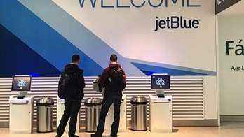 Travelers check-in at a JetBlue Airways kiosk at John F. Kennedy Airport in the Queens borough of New York, U.S., January 24, 2017. REUTERS/Shannon Stapleton - RTSX6D7