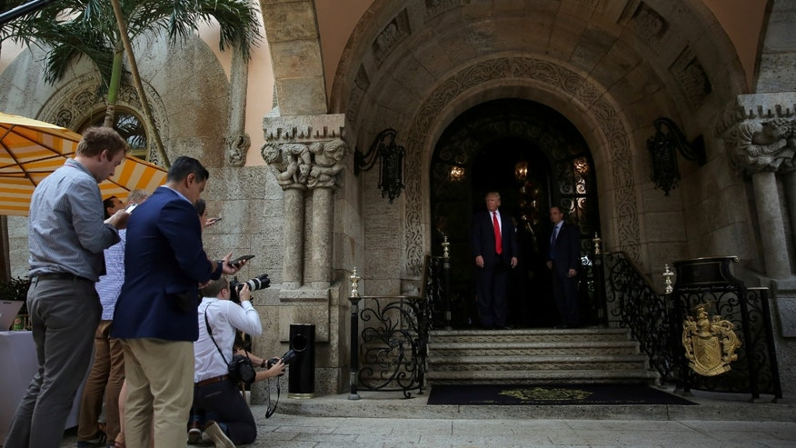 President Donald J. Trump talks with the media at Mar-a-Lago estate in Palm Beach, Florida, U.S., December 21, 2016.