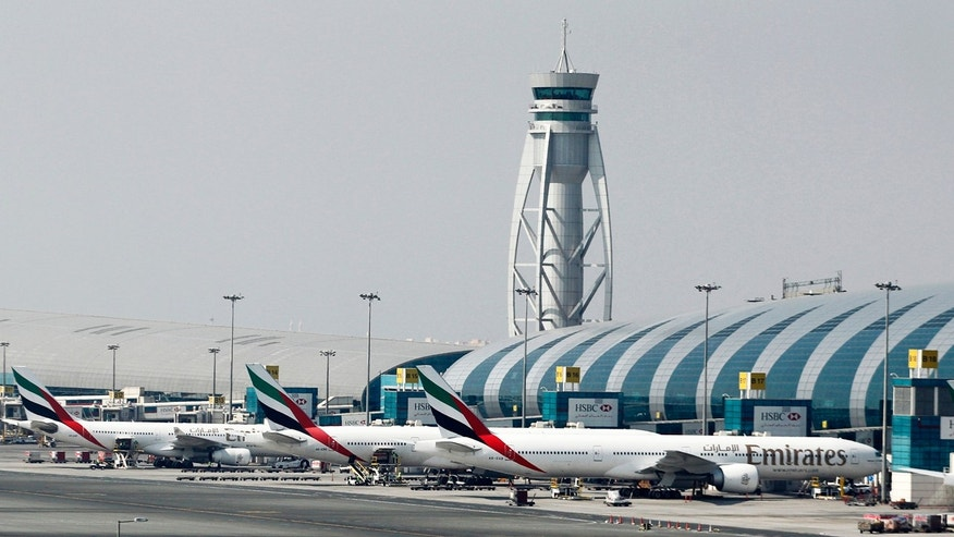Emirates airplanes at Dubai International Airport.