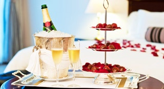 Honeymoon suite with chocolate strawberries and a bottle of champagne