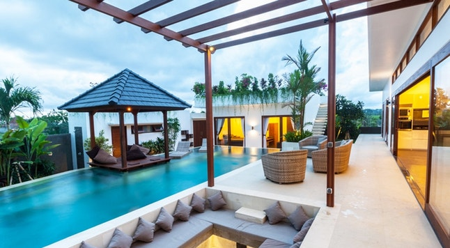 A tropical modern villa exterior view with built in sofa