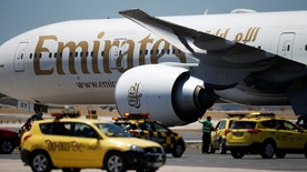 An Emirates plane is seen at Lisbon's airport, Portugal June 24, 2016. REUTERS/Rafael Marchante - RTSHVPT