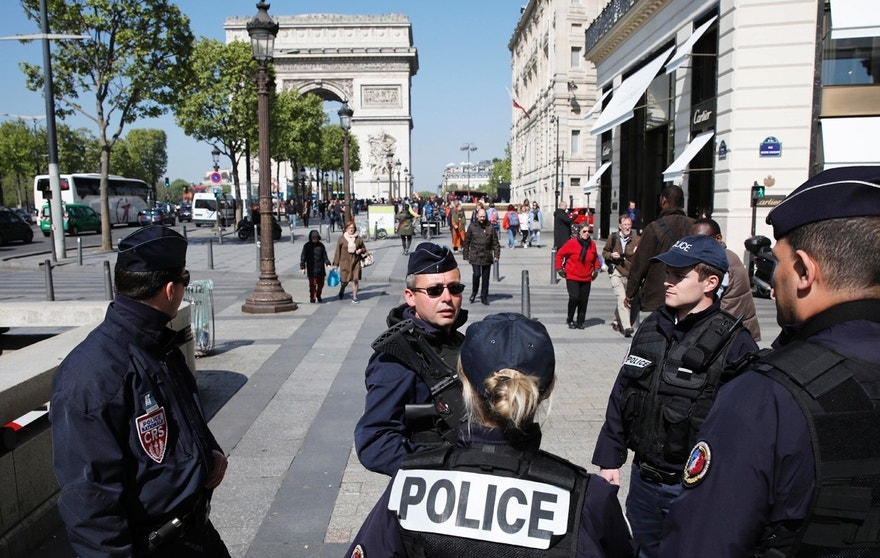 French police patrol the Champs Elysees Avenue the day after a policeman was killed and two others were wounded in a shooting incident in Paris, France, April 21, 2017. REUTERS/Benoit Tessier - RTS13AJ1