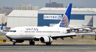 FILE - In this Sept. 8, 2015, file photo, a United Airlines passenger plane lands at Newark Liberty International Airport in Newark, N.J. Twitter users are poking fun at United's tactics in having a man removed from an overbooked Chicago to Louisville flight on April 9, 2017.  (AP Photo/Mel Evans, File)