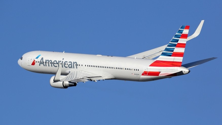 An American Airlines passenger wasn't thrilled about being bumped from first-class.