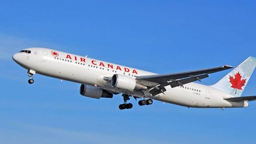 An Air Canada flight from Jamaica to Toronto was forced to make an emergency stop in Florida on Tuesday because a passenger attacked the crew with coffee pots and tried to open the cabin door midflight, officials said.