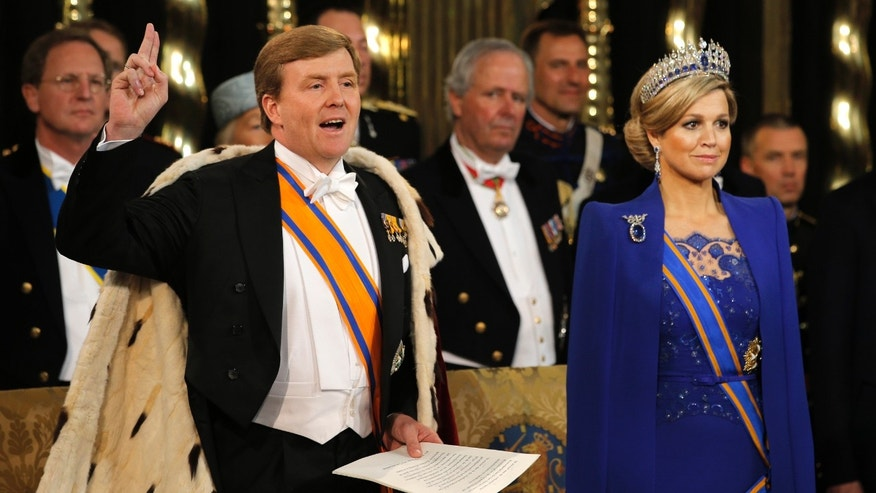 Dutch King Willem-Alexander takes the oath as he wife Queen Maxima stands at his side during his inauguration inside the Nieuwe Kerk or New Church in Amsterdam, The Netherlands, Tuesday April 30, 2013. Around a million people are expected to descend on the Dutch capital for a huge street party to celebrate the first new Dutch monarch in 33 years. (AP Photo/Peter Dejong, Pool)
