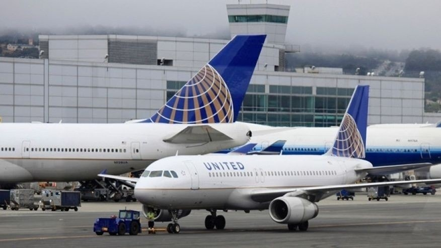 At least five people suffered minor injuries Tuesday night after a United Airlines plane engine caught fire at Newark Liberty International Airport, officials said.