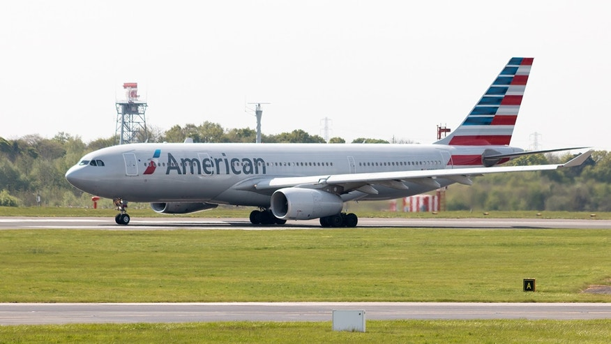 A man is facing federal charges for trying to bite a flight attendant before jumping off plane