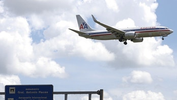 An American Airlines airplane prepares to land at the Jose Marti International Airport in Havana September 19, 2015. The Obama administration announced wide-ranging new rules on Friday to ease trade, travel and investment restrictions with Cuba, the latest effort to chip away at the long-standing U.S. economic embargo amid a diplomatic thaw between the two former Cold War foes. The announcement came just as Pope Francis, who played an instrumental role in the diplomatic opening late last year, prepares to visit Cuba this weekend before heading to the United States next week. The Vatican has long condemned the embargo against Cuba. REUTERS/Carlos Garcia Rawlins - RTS1XL5