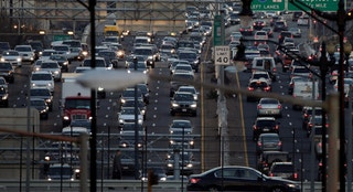 Rush-hour traffic passes through Washington, U.S., December 20, 2016.   REUTERS/Joshua Roberts - RTX2VXTJ