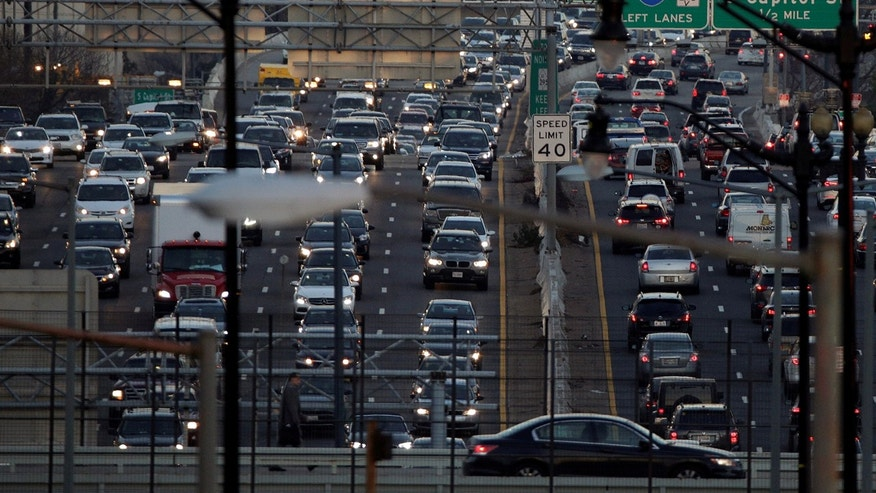 Rush-hour traffic passes through Washington, U.S., December 20, 2016.