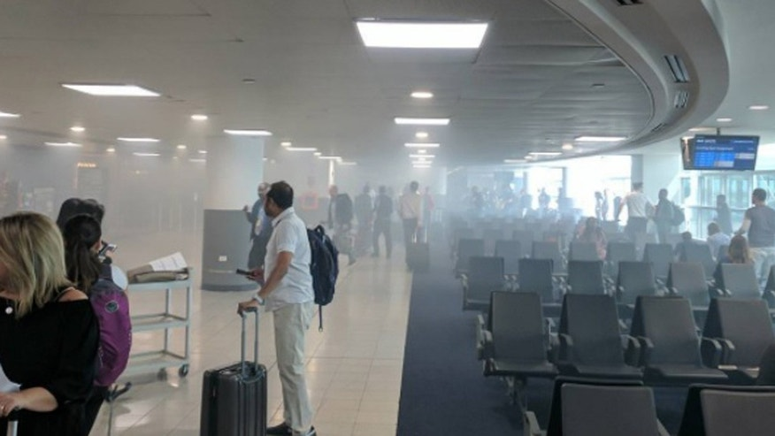 A restaurant fire at John F. Kennedy Airport in New York filled Terminal 4 with smoke.