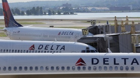 Delta Airlines planes are parked at gates after the airlines computer systems crashed leaving passengers stranded as flights were grounded globally at Ronald Reagan Washington National Airport in Washington, U.S., August 8, 2016.      REUTERS/Joshua Roberts - RTSLTSM