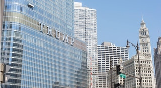 Chicago, Illinois, United States - April 15, 2016: Trump building seen from the ground level during a warm spring day.