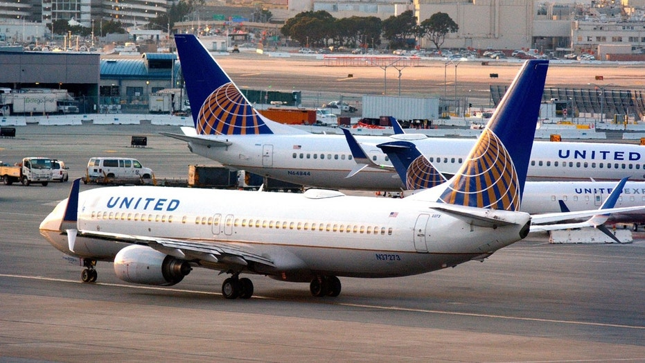 An unruly United passenger was restrained by five men after causing a disturbance mid-flight.
